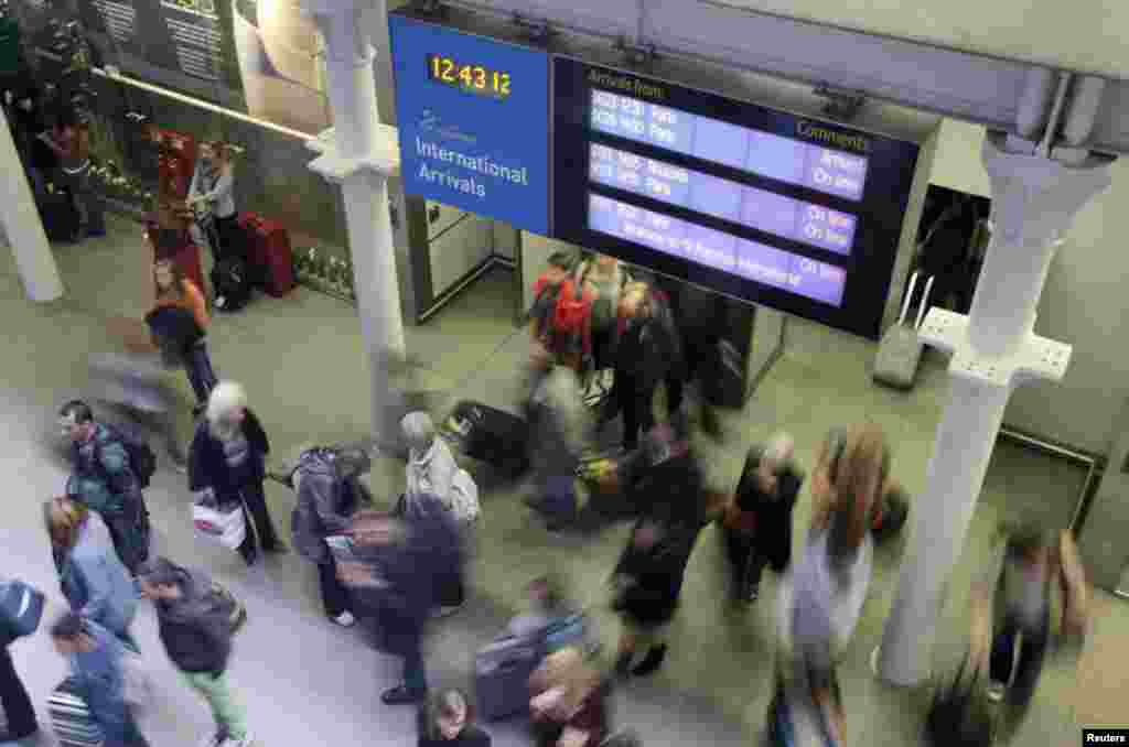 Britain said it would start screening passengers entering the country through London's two main airports and the Eurostar rail in an effort to curtail the spread of Ebola, Oct. 10, 2014.