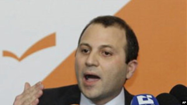 Lebanese Energy Minister Jibran Bassil announces the resignation of Hezbollah ministers and their allies during a press conference in the northern Beirut suburb of Rabieh, 12 Jan 2011
