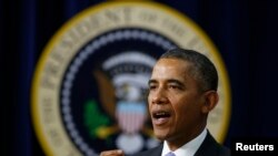 U.S. President Barack Obama gives remarks at an event on Expanding College Opportunity inside the Eisenhower Executive Office Building on the White House complex in Washington, January 16, 2014. REUTERS/Larry Downing (UNITED STATES - Tags: POLITICS E