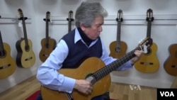 """Tony"" Acosta plays his guitar. He is a classical musician and business owner, and makes fine nylon strings used in classical and flamenco guitar."