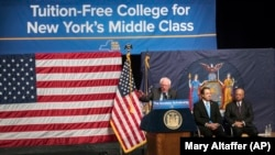 Senator Bernie Sanders, left, is joined by New York Governor Andrew Cuomo, center, and Chairperson of the Board of Trustees of The City University of New York William C. Thompson, as he speaks about a proposal for free tuition at state colleges.