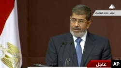 In this image from a live broadcast on Egyptian State Television, Egyptian President Mohammed Morsi speaks to the constituent assembly in Cairo on Dec. 1, 2012.