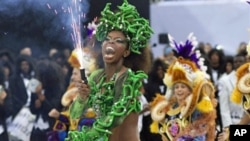 A dancer performs during the parade of the Vai Vai samba school in Sao Paulo, Brazil, March 5, 2011