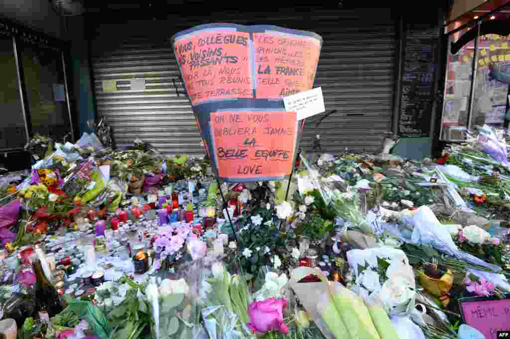 Flowers, candles and messages left as a memorial outside of La Belle Equipe bar, in the 11th district of Paris, following a series of coordinated terrorists attacks on November 13.