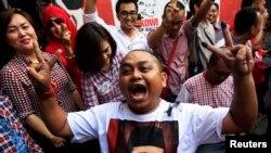 Người ủng hộ ông Widodo ăn mừng kết quả bầu cử tại Makassar, nam Sulawesi, ngày 9/7/2014.