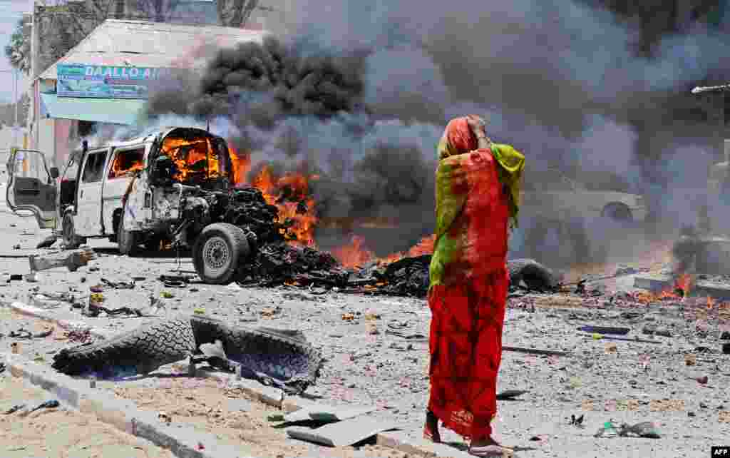 A Somali woman reacts near the site of a car bomb in central Mogadishu, March 18, 2013. At least eight people were killed in one of the bloodiest attacks in the war-ravaged capital in recent months, police said.