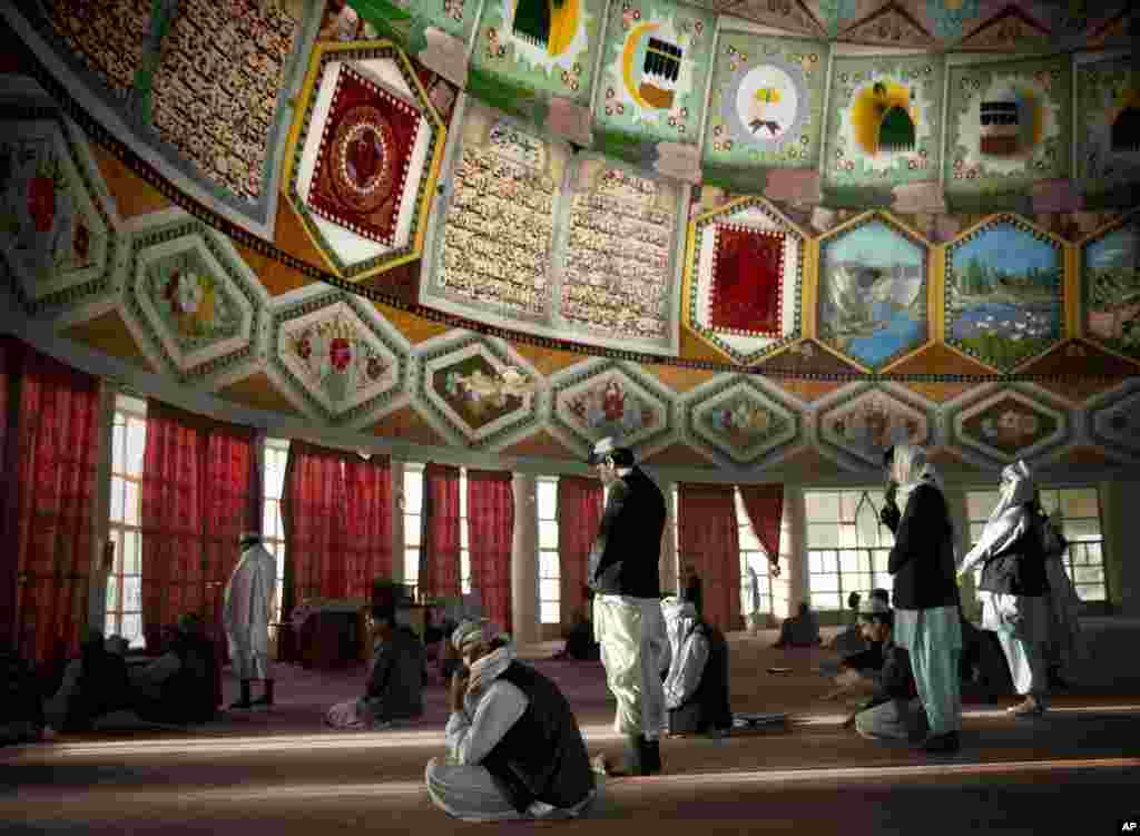 Afghan men gather for prayers inside the Eid Gah mosque, one of the country's largest mosques in Kandahar, southern Afghanistan.