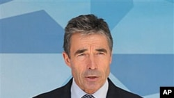 NATO Secretary General Anders Fogh Rasmussen addresses the media after he met with NATO ambassadors, at NATO headquarters in Brussels, Tuesday, June 26, 2012. According to NATO, Syria's downing of a Turkish jet is 'unacceptable,' and NATO condemns 'it in