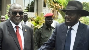 FILE - South Sudan's First Vice President Riek Machar, left, and President Salva Kiir are pictured after the first meeting of a new transitional coalition government, in the capital, Juba, April 29, 2016.