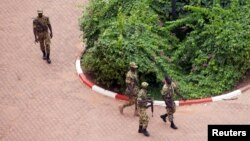 FILE - Presidential guard soldiers are seen on the grounds of the Laico Hotel in Ouagadougou, Burkina Faso, Sept. 20, 2015.