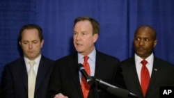 Michigan Attorney General Bill Schuette addresses the media, Wednesday, April 20, 2016 in Flint, Mich.