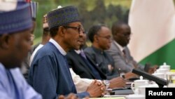 Nigerian President Muhammadu Buhari, second left, talks with Chinese officials during a meeting at the Great Hall of the People in Beijing, April 13, 2016.