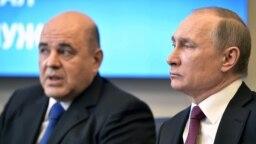 Ông Mikhail Mishustin (trái).