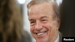 FILE - Italy's film director Franco Zeffirelli smiles during a ceremony at the British Embassy in Rome, Nov. 24, 2004.