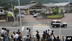Journalists gather in front of Tsukui Yamayuri-en, a facility for the handicapped where a number of people were killed and dozens injured in a knife attack in Sagamihara, outside Tokyo Tuesday, July 26, 2016.