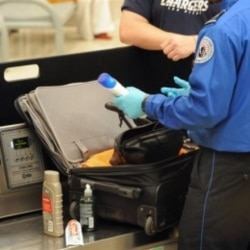 A Transportation Security Administration officer finds unallowable liquids in a passenger's carry-on luggage at Hartsfield-Jackson Atlanta International Airport. The TSA was created after the September 11 terrorist attacks.
