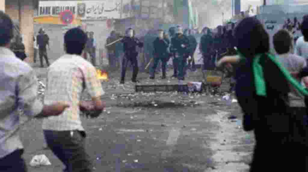 In this photograph posted on the internet, Iranian riot police clash with demonstrators in Tehran, Iran Saturday June 20, 2009. (AP Photo)
