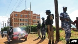 Policemen stand guard outside the Daily Monitor newspaper's offices in Kampala on May 20, 2013