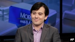 """FILE - Martin Shkreli is interviewed by Maria Bartiromo during her """"Mornings with Maria Bartiromo"""" program on the Fox Business Network, in New York, Aug. 15, 2017."""