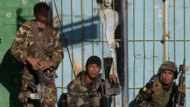 Government troops prepare for an assault on Muslim rebels in Zamboanga, Philippines, Sept. 13, 2013.