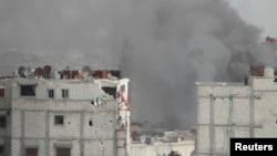 4月1日,叙利亚霍姆斯地区遭到叙政府军的炮击,硝烟弥漫