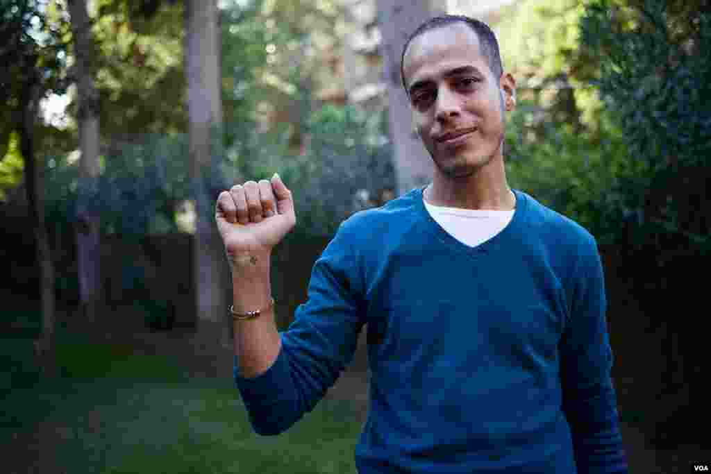 Former Christian Milad Soliman says he became an atheist after he entered university. He still has a small Coptic cross tattooed on his wrist, Oct. 25, 2013, Cairo. (Yuli Weeks for VOA)