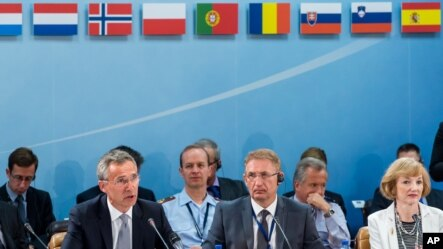 NATO Secretary General Jens Stoltenberg, left, talks during a North Atlantic Council Meeting at NATO headquarters in Brussels, July 28, 2015.