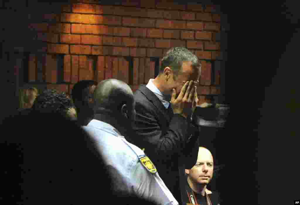 Athlete Oscar Pistorius weeps in court in Pretoria, South Africa, at his bail hearing in the murder case of his girlfriend Reeva Steenkamp.
