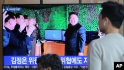 FILE - People watch a TV showing a photo of North Korean leader Kim Jong Un during a news program reporting a North Korean missile launch, May 5, 2019, at the Seoul Railway Station in Seoul, South Korea.