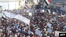 Demonstrators protesting against Syria's President Bashar al-Assad march through the streets after Friday prayers in Hula 16/10/2011