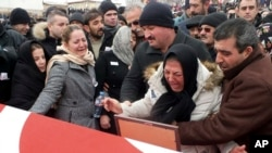 Family members weep in Cayiralan, Yozgat, Turkey, during funeral prayers for Turkish soldier Oktay Durak, Dec. 23, 2016. Durak was killed with 15 others by IS militants in al-Bab, Syria.