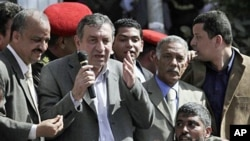 Egyptian PM-designate Essam Sharaf, with microphone, speaks to demonstrators in Tahrir Square in Cairo, March 4 2011