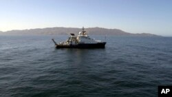 In this March 2021 image provided by Scripps Institution of Oceanography at UC San Diego, the research Vessel Sally Ride is seen off the coast of Santa Catalina Island, California. (Scripps Institution of Oceanography at UC San Diego via AP)