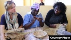 Tourists being taught how to weave some traditional items at Amagugu International Heritage Center. (Photo: Amagugu)