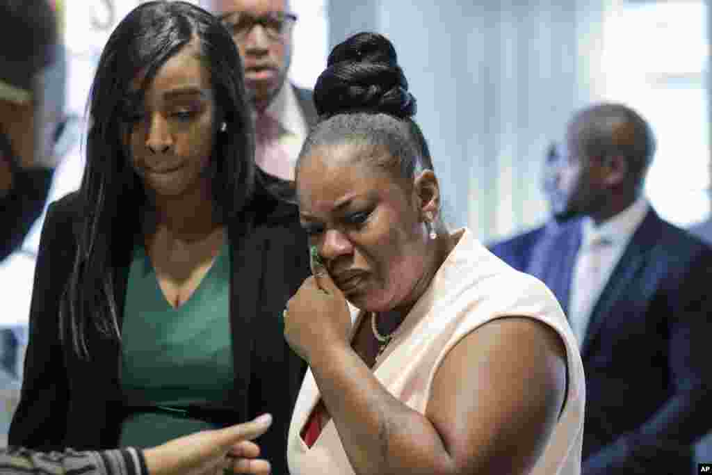 Tomika Miller, right, widow of Rayshard Brooks, cries as she leaves a news conference, June 17, 2020 in Atlanta, Georgia. Fulton County District Attorney Paul L. Howard Jr. announced former Atlanta Police Officer Garrett Rolfe faces charges including felony murder in the fatal shooting of Rayshard Brooks on June 12.