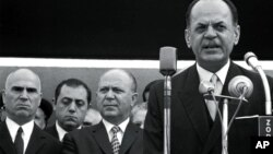 FILE - In this 1967 file photo, Greek dictator George Papadopoulos, right, Stylianos Pattakos, far left, and Nikolaos Makarezos, center, are seen in Athens. Stylianos Pattakos, the last survivor among the leaders of a 1967 coup that ruled Greece for seven years, has died at 103.