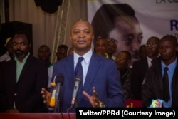 FILE - Emmanuel Ramazani Shadary, nominated by President Joseph Kabila for the presidential election scheduled for December 23, speaks at a rally in Kinshasa, Sept. 25, 2018.