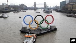 Backdropped by the historic Tower Bridge, a giant Olympic Rings floats on the River Thames in London in the run-up for the Olympic games.