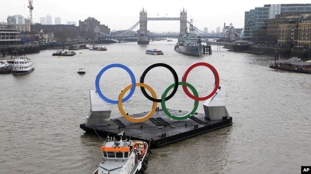 Backdropped by the historic Tower Bridge, a giant Olympic Rings floats on the River Thames in London in the run-up for the Olympic games, during its launch to mark 150-days until the start of the London 2012 Olympic games, February 28, 2012.