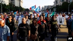 FILE - Supporters of Malaysian opposition leader Anwar Ibrahim march toward the Palace of Justice at Putrajaya, Malaysia, Feb. 10, 2015.