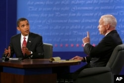 FILE - Democratic presidential candidate Sen. Barack Obama, D-Ill., and Republican presidential candidate Sen. John McCain, R-Ariz., talk during the presidential debate, Oct. 15, 2008, at Hofstra University in Hempstead, N.Y.