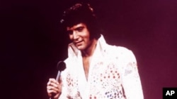 FILE - Elvis Presley performing in 1973.