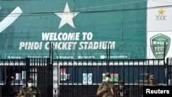 Police stand guard outside Rawalpindi Cricket Stadium after New Zealand's team pulled out of a Pakistan tour over security concerns, in Rawalpindi, Sept. 17, 2021.