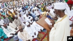 FILE - Nigeria Muslims listen to the sermon by Imam Bashir Umar, during Eid al-Fitr prayers in Lagos, Nigeria, to mark the end of the month of Ramadan, June 25, 2017.