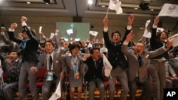 Tokyo 2020 delegation celebrates as city is awarded Summer Games during 125th IOC session, Buenos Aires, Sept. 7, 2013.