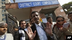 Manohar Lal Sharma (C), lawyer of one of the accused, Mukesh Singh, speaks with the media outside a district court in New Delhi, January 10, 2013.