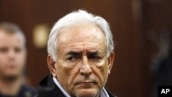 International Monetary Fund (IMF) chief Dominique Strauss-Kahn appears in Manhattan Criminal Court during his arraignment in New York May 16, 2011.