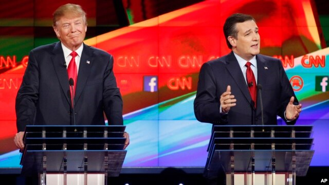 Ted Cruz, right, makes a point as Donald Trump reacts during the CNN Republican presidential debate at the Venetian Hotel & Casino on Dec. 15, 2015, in Las Vegas.