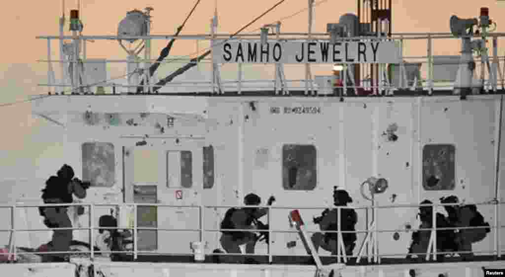 South Korean naval special forces take up positions during an operation to rescue crew members on the Samho Jewelry vessel in the Arabian Sea, Jan. 21, 2011.