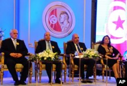 FILE - Left to right, Tunisian Nobel Peace Prize Winners Houcine Abassi, Abdessattar Ben Moussa, Fadhel Mafoudh and Wided Bouchamaoui are seen at a ceremony in Tunis, Nov. 9, 2015.